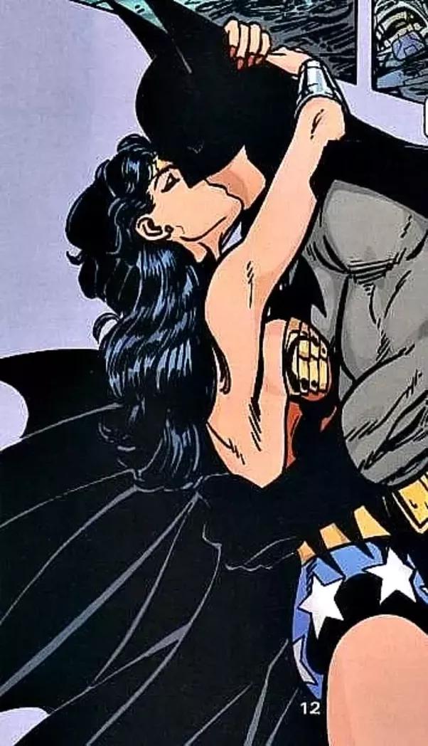 woman Batman kissing wonder and