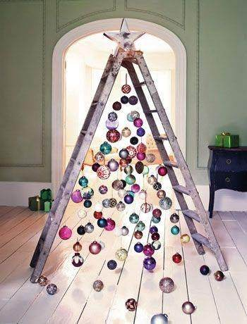 cant hang things from your ceiling well use a ladder this awesome tree looks fantastic and had many great colors in it - When Can You Decorate For Christmas