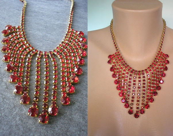 c8fe68cba Red Rhinestone Statement Necklace. The fringed waterfall design is a  timeless choice for this captivating piece. It comes in bold red on a  golden metal ...