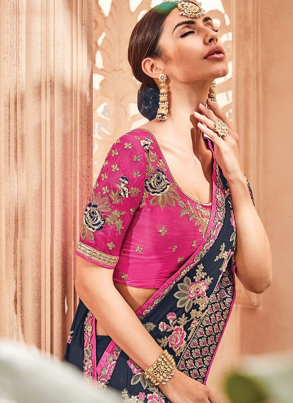 7f7bbedd955965 Cape-style Saree Blouse: If you are looking to create a contemporary look  with a traditional attire like saree, then cape blouse is your pick.