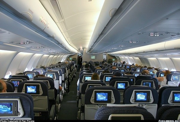 Now, Here Is A Picture Of The Cabin Of An Airliner Without The Sky Interior.  The Luggage Bins Are Positioned So Lowly, It Looks And Feels So  Claustrophobic.