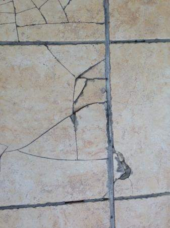 What Make Tile Crack How Do You Fix It Once Its In Place Quora