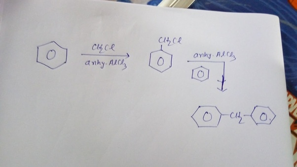 What happens when benzene reacts with dichloromethane in the