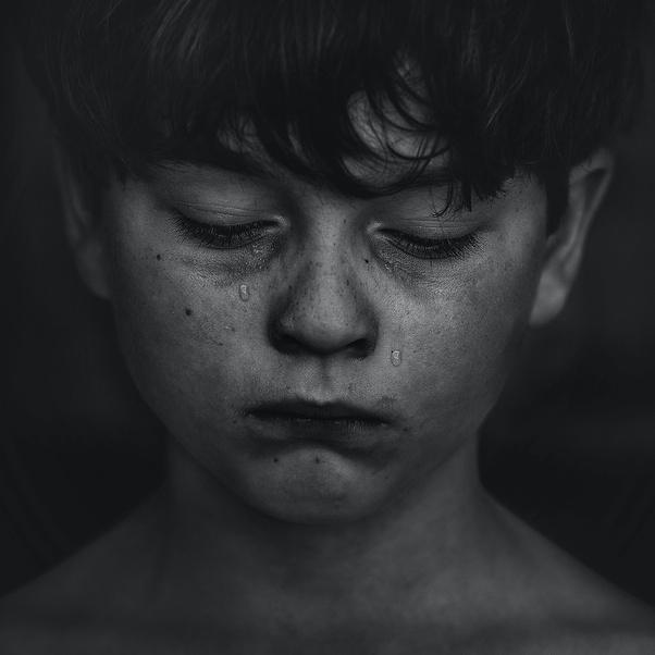 Black and White image of boy sad and crying.