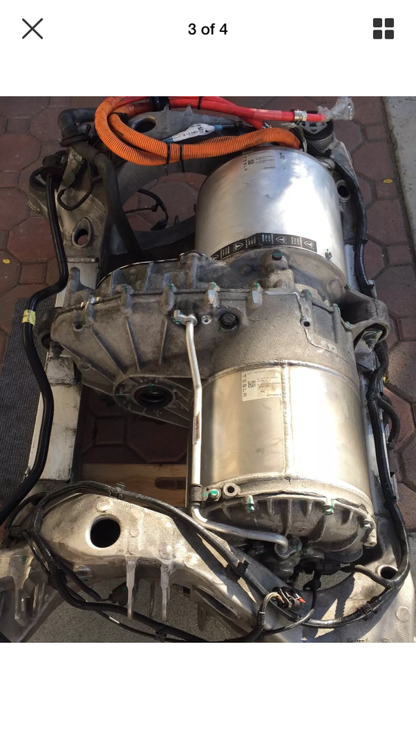 tesla electric car motor. the side opposite from inverter is motor. middle bit between and motor transaxle which contains a single drive ratio. tesla electric car w
