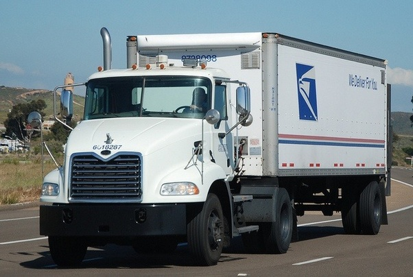 Why do USPS vehicles have right hand drive? - Quora
