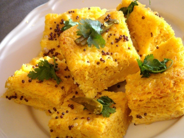 What popular indian dishes are non spicy quora dhoklas are sort of a soft fluffy rice chickpea cakes with a slightly tangy taste due to fermentation forumfinder Images