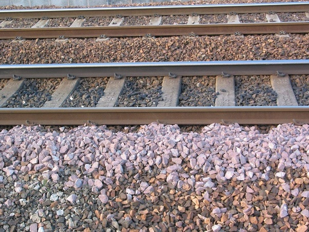 David S. Rose's answer to Why are there crushed stones alongside rail tracks?