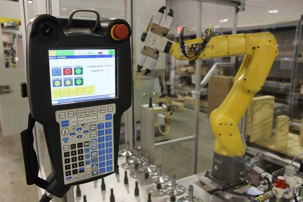 What programming language is used to control industrial robots? - Quora