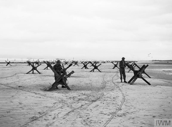 What were those 'X' shaped iron crosses on the beach of