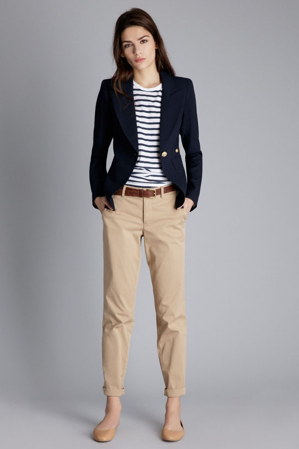 b5bc0f17 Above: In this striking outfit, a blue and white striped shirt with a navy  blue blazer is worn with a pair of beige pants. Also pay attention to both  her ...