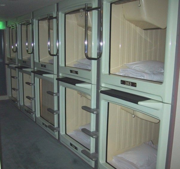 A Capsule Hotel In Osaka. That Bulge In The Top Left Of Each Room Is A TV.