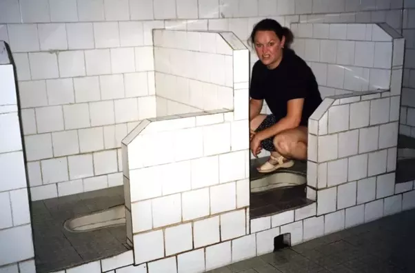 women using mens urinal trough