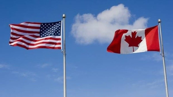 why are canadian flags and american flags put together in many