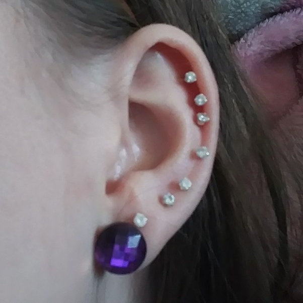 Should I Get My Piercings On My Left Ear Repositioned Or Leave It