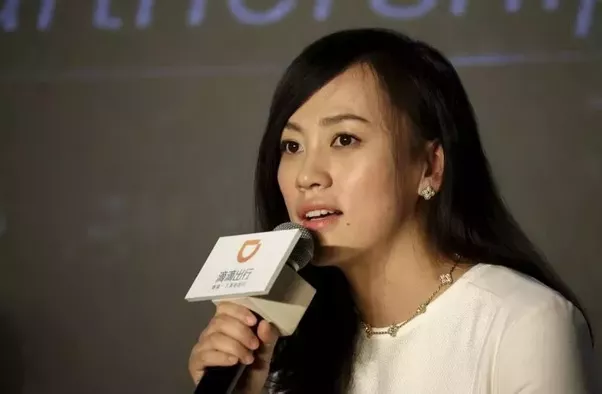 What are the competitive dynamics between Uber and Didi in China?