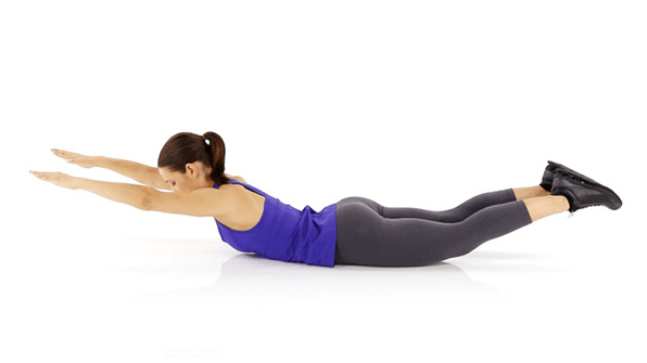 Lie Facedown With Legs Together Forehead Resting On Mat Arms Out In Front Of You Palms Down Squeezing Your Abs And Butt Lift Directly