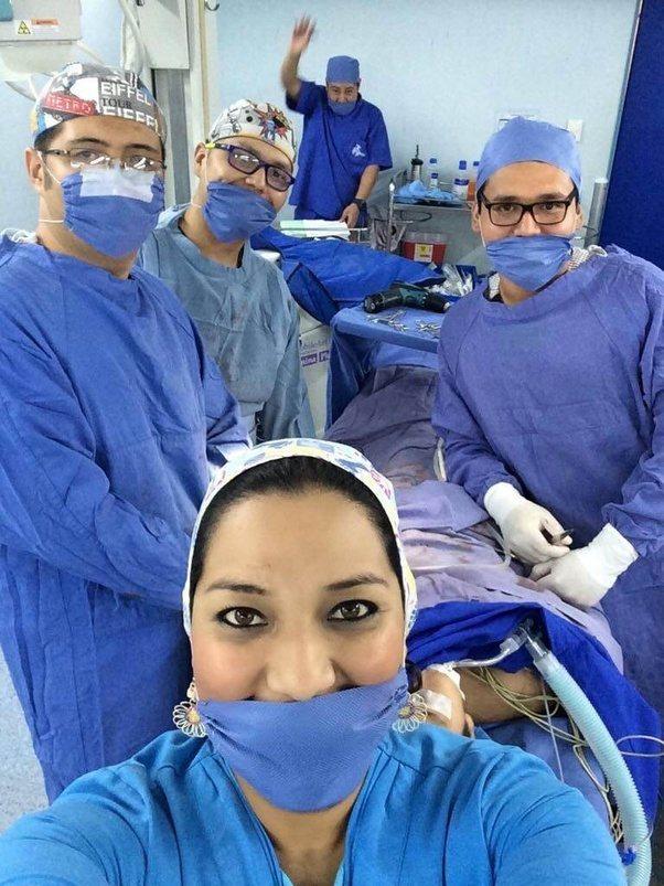 Doctors party photos while patient gets plastic surgery