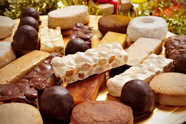 however the most typical christmas food in spain are the sweets turrn polvorones marzipan and other confections made primarily with almonds and honey