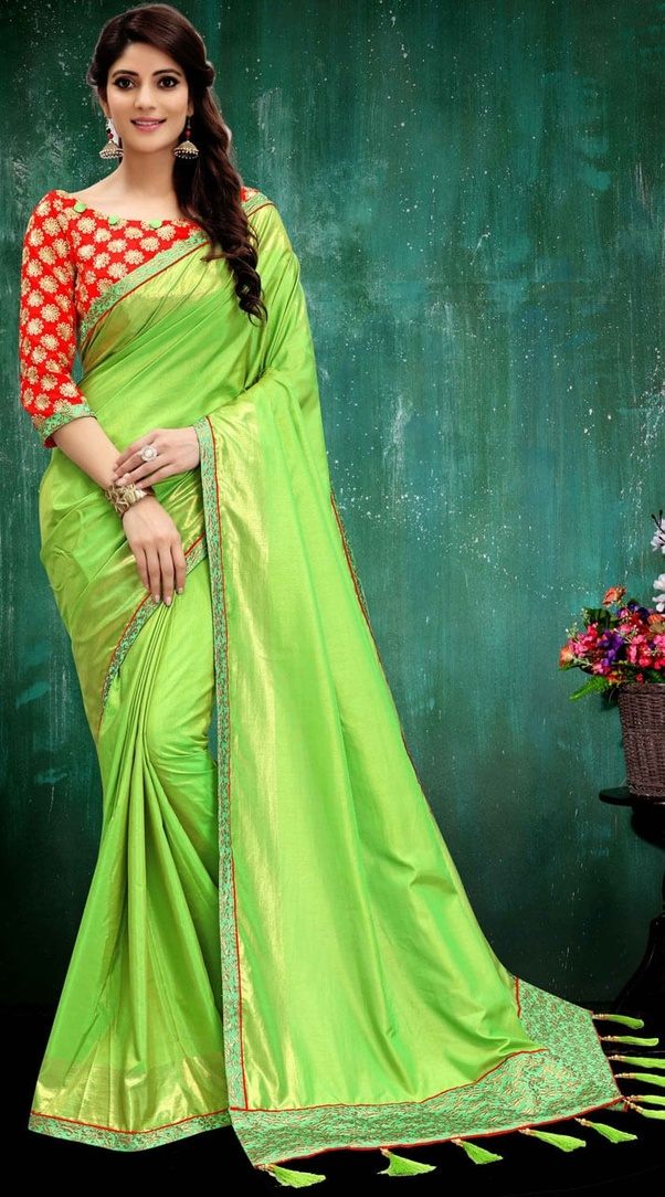 d9621b9ae1aba Orange brocade blouse looks gorgeous with light green silk saree.