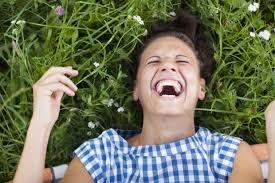why do girls giggle