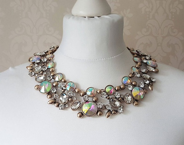 29cd48bb5 Rhinestone and iridescent gemstones blend amazingly on this unique piece  making it one of the best statement necklaces. It could grace virtually any  dress ...