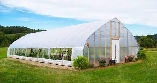 this is an actual greenhouse it lets in sunlight which heats the air inside but traps that heat thanks to the plastic or glass membrane