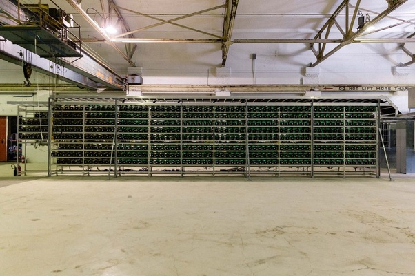 How is a calculated needed cooling system for a Bitcoin