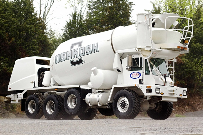 Why are American concrete mixer trucks often pouring the
