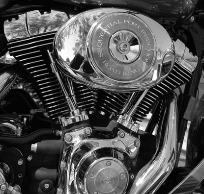 What is the technical reason why Harley-Davidson engines are