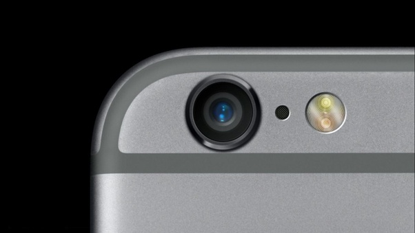 What is the small black dot between camera and flash in iPhone 6 and 6S? -  Quora