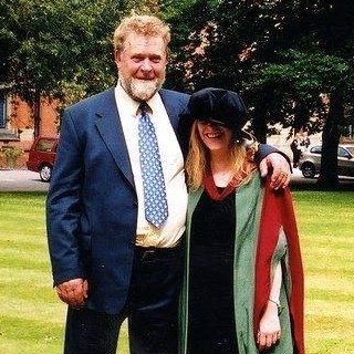 My father and I at my PhD graduation.