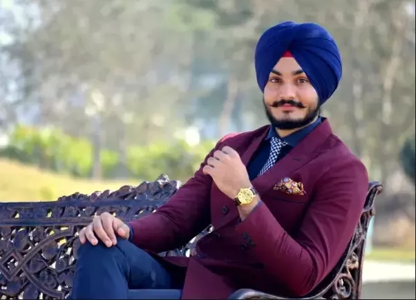 Which color turban matches with maroon blazer over sky ...