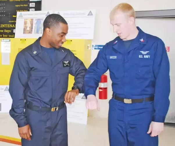 the navy working uniform or blueberries or aquaflage were designed to replace several other working uniforms such as the above coveralls and the old