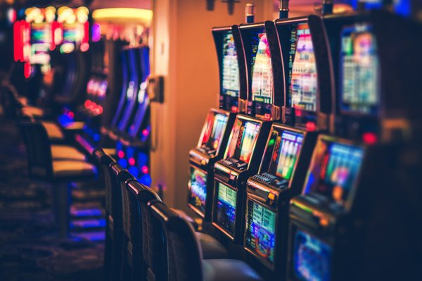 I won a jackpot at a local casino and they kept my money until I provided  an ID. Now they're refusing to pay me saying I look suspicious. What do I do